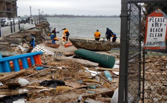 Hurricane Sandy left lots of debris at our usual beach destination on City Island. The sign at right provides irony...