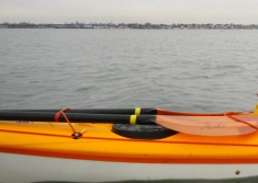 The NYC skyline above the deck of Alex's kayak