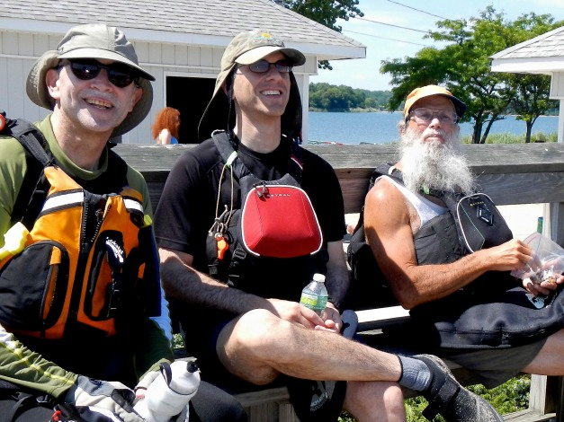 Alan, Rob, Gidon relax at Glen Cove beach. A mysterious redhead has come between them (hey, same color as Rob's kayak!)