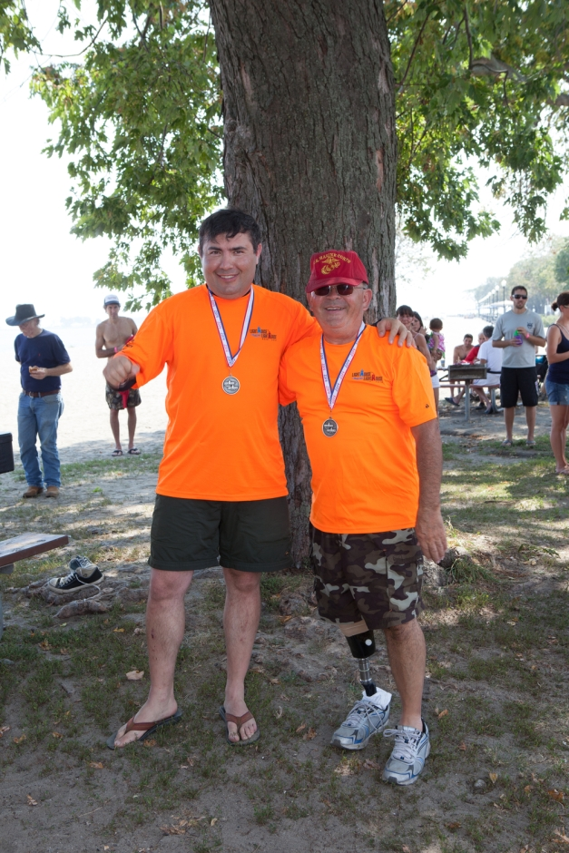 Our balletic friend, Felix, and teammate Cesar: silver-medalists in the 14-mile race at 3:20:30. Photo by Dan Marino.