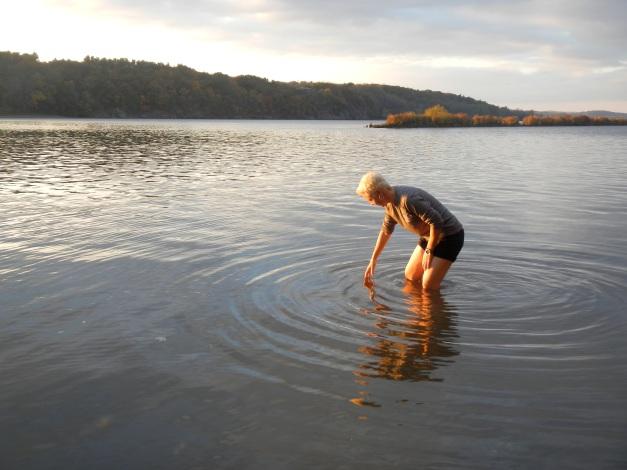 Johna retrieving beer from our impromptu cooler—the Hudson River. October 2013