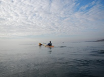 Alex and Jim paddle towards Columbia, Davids and Huckleberry Islands