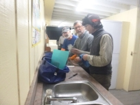 Jack, Rick and Alex (headlamp) do the dishes at RV campground