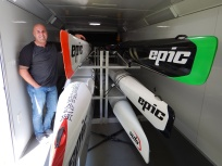 Paul couldn't decide which of his skis to bring, so he brought them all!