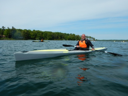 Paul braces with his paddle on the water